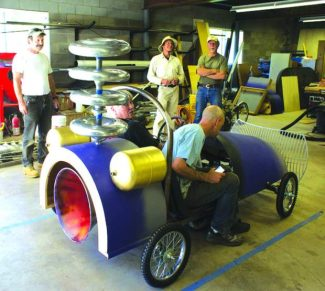 Ensemble Designs puts the finishing touches on its entry for the Nevada City Adult Soapbox Derby, hosted by AJA Video Systems, June 16 at Pioneer Park in Nevada City.