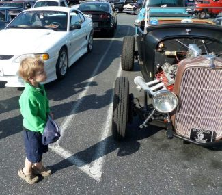 Future gearhead, three-year-old Ethan Anthney studies a '32 Ford hot-rod roadster.