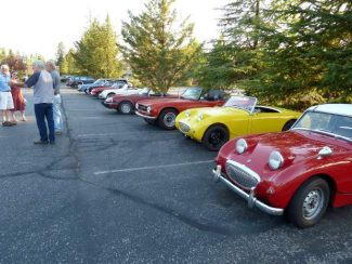 """A pair of legendary """"bug-eyed"""" Austin Healey Sprites start the line of sports cars at a Sierra Sports Car Club meeting."""