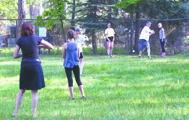 Participants in the Strawberry Festival play baseball at the Nevada County Fairgrounds Friday evening.