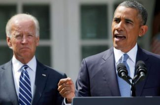 President Barack Obama stands with Vice President Joe Biden, left, as he makes a statement about Syria in the Rose Garden of the White House in Washington, Saturday, Aug. 31, 2013. Obama says he has decided that the United States should take military action against Syria in response to a deadly chemical weapons attack. But he says he will seek congressional authorization for the use of force. (AP Photo/Charles Dharapak)