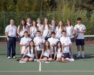 The Forest Lake Christian coed tennis team poses together on their home court.