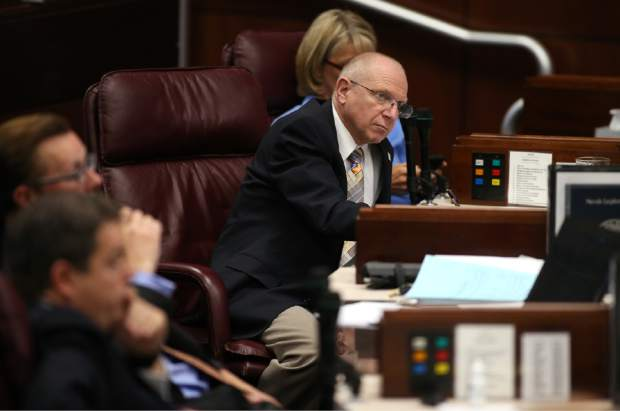 Nevada Senator Joe Hardy, R-Boulder City, listens to testimony from economic experts on the Senate floor during the second day of a special session at the Nevada Legislature, in Carson City, Nev., on Thursday, Sept. 11, 2014. Lawmakers are considering a complex deal to bring Tesla Motors to Nevada. (AP Photo/Cathleen Allison)