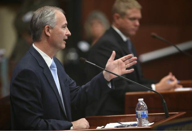 Steve Hill, with the Governor's Office of Economic Development, answers questions on the Senate floor during the second day of a special session at the Nevada Legislature, Thursday, Sept. 11, 2014,  in Carson City, Nev.  Lawmakers are  considering an unprecedented package of up to $1.3 billion in incentives to bring Tesla Motors' $5 billion battery factory to the state.  (AP Photo/Cathleen Allison)