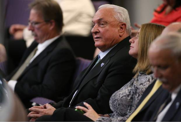 Lance Gilman, principal and director of the Reno Tahoe Industrial Center, listens to testimony during the second day of a special session at the Nevada Legislature, in Carson City, Nev., on Thursday, Sept. 11, 2014. Lawmakers are considering a complex deal to bring Tesla Motors to Nevada. The $5 billion battery factory is proposed for Gilman's center, east of Reno. (AP Photo/Cathleen Allison)