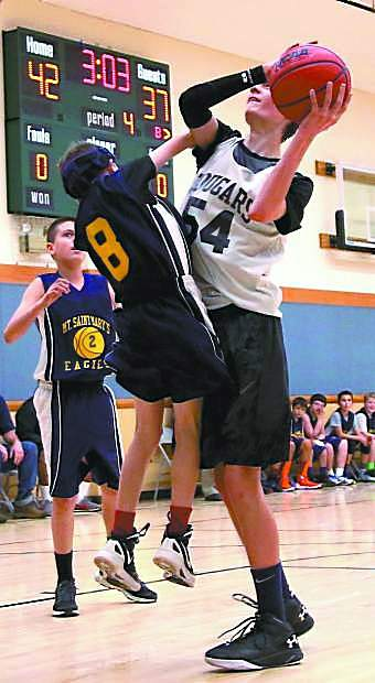Camptonville's Kyle Ledson shoots the ball during a game against Mt. Saint Mary's Wednesday night. Ledson is tallest 8th grader on his team and also plays in a local blue grass band.