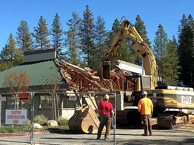 Sierra Foothills Construction workers tear the roof from the former site of Perko's, and later Siena's Cafe and Grill, Thursday afternoon. The site will be the home of a new Sierra Central Credit Union branch in Grass Valley's Glenbrook Basin.