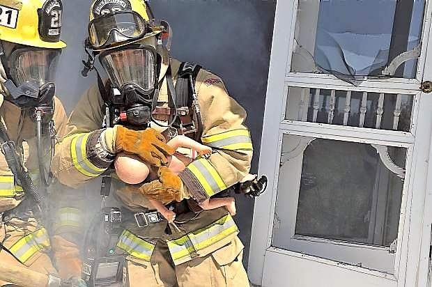 The Higgins Fire District of Nevada County held a training exercise at a soon-to-be-demolished home in May 2013. The district will layoff six employees due to the rejection of a parcel tax increase by area voters.