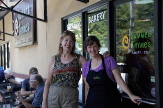 Partners in English Language Learning board President Diane Miessler, left, and Summer Thyme's Bakery and Deli owner Amy Cooke stand togeher outside Cooke's Grass Valley cafe.