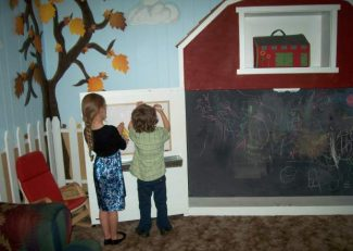 Children enjoy the new Barnyard Playroom at the KARE Crisis Nursery. The room was a project sponsored by Soroptimist International of Grass Valley.