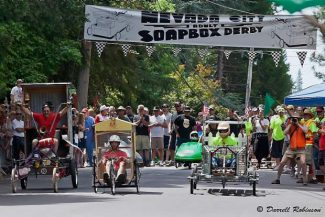 """Participants in last year's Nevada City Soap Box Derby race down Nimrod St. near Pioneer Park. The derby is taking sign-ups from 2 to 5 p.m. Sunday at Matteo's Public in Nevada City, and this year, teams can enter in either """"Art"""" or """"Speed"""" categories. The race will be June 21. Teams will race down a half-mile course past historic Pioneer Park. Advanced registration is also available at the Nevada City Chamber of Commerce office. For  information, visit http://ncderby.com or contact Rich Bodine at 530-264-6233. Build for speed or build for fun!"""