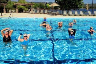 Students in Betty Sullivan's swim exercise class at the Lake Wildwood pool enjoy one of their last classes of the season.