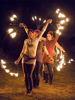 """Performers from the group Beyond Fire Tribe lit up the night Friday at """"Fire and Dance,"""" a celebration of art and education at the Woolman Semester School in Nevada City."""