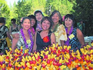"""The August 24 luau benefit for the Community Asian Theatre of the Sierra sold out. The event was a celebration of CATS' 20th anniversary and upcoming 2014 production of """"Miss Saigon."""" The event brought in close to $2,000. The pig weighed 157 pounds and yielded roughly 230 servings."""
