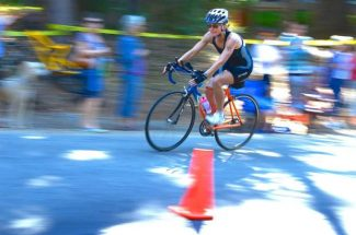 The 19th annual Barbara Schmidt Millar Celebration of Life Women's Triathlon, held Sunday morning, begins at Cascade Shores at Scotts Flat Lake. Shown is Troy Devine, who makes a turn to go down to the lake and start the run that finishes on Spanish Lane. The purpose of the triathlon is to honor those who have died from cancer and to raise funds to pay for mammograms and scholarships for female Nevada Union graduates who pursue careers in  healthcare. For the complete story, go to page B10 in today's paper.