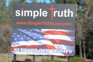 A large sign supporting the troops stands on Combie Road at Highway 49. It was put up by people from Simple Truth Church, 10556 Combie Road.