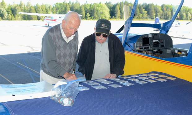 J. Perry Thomas, left, and Harold Wolfe of Grass Valley check name tags of the pilots of the United Flying Octogenarians (UFO) who flew in the Nevada County Air Park. Wednesday morning. The national organization has around 1,500 members. Their membership requires that they did fly at least once after their 80th birthday. Thomas, who will turn 99 this year, is a retired United Airlines captain.