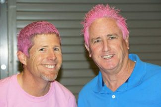 Union Hill teachers Mike Kochis and Chuck Ross dyed their hair pink and dressed in ballerina tutus to inspire students to meet their goal for the school's annual food drive.