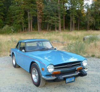 The TR6 was produced from 1969 until 1976.  The TR6's body was designed by Germany's Karmann body works and it had four-wheel independent suspension. Because of new U.S. safety regulations, the '74 had black rubber bumper guards added.