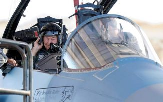 Retired Air Force Brig. Gen. Charles Yeager straps into an F-15D for a re-enactment flight commemorating his breaking of the sound barrier 65 years ago on Sunday, Oct. 14, 2012, at Nellis Air Force Base, Nev. (AP Photo/Isaac Brekken)