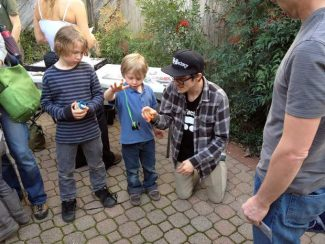 Tyler Severance from YoYo Factory (right) shows Sawyer Brush, 5, how to properly handle a yo yo while big brother Lennon Brush, 8, watches. YoYo Factory staff will be at Mountain Pasttimes in Nevada City through Friday.