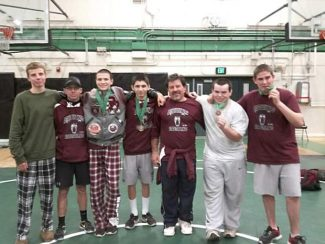 Members of the Bear River wrestling team show off their medals after competing in a tournament Saturday at El Camino High School.