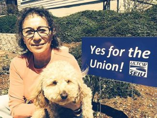 Karen Lorini, an Eskaton homeowner, and her poodle, Max, sit near a sign at her home supporting the creation of a union for Eskaton employees. The union election is set for June 3.