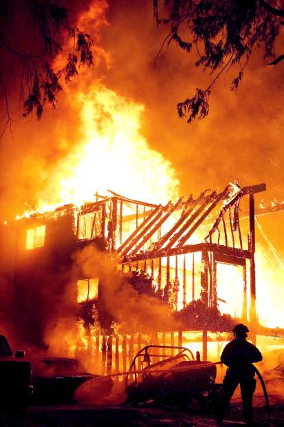 Structure fire engulfs a Cascade Shores home after midnight Friday night.