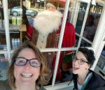 Cornish Christmas event coordinator Shanin Ybarrondo (left) and Grass Valley Downtown Association program specialist Marissa Hernandez, pose for a selfie with Santa to help promote their 'Where's Santa' facebook contest.