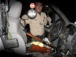 """During the production of """"Endangered Species,"""" Warden Jerry Karnow was fimed inspecting the cab of a truck that had three people spotlighting deer, finding three loaded rifles, a loaded pistol and a bottle of whiskey in the bed of the truck."""
