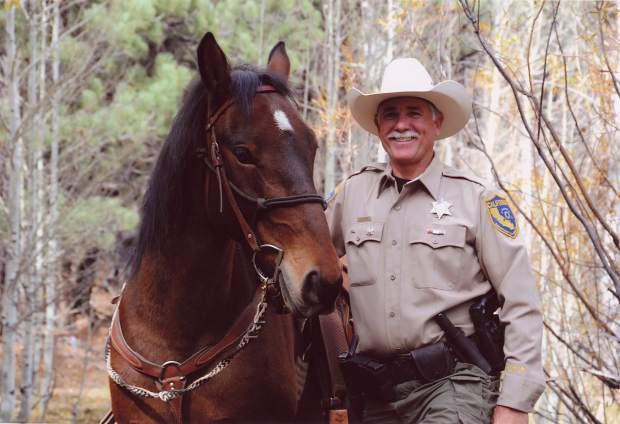 California Fish and Wildlife Warden Jerry Karnow with his horse, Modoc.