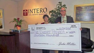 Above, John Miller, right, of the Intero Foundation, presents Cathy Fagan of The Nevada County Diaper Project with a grant in the amount of $1,600. The foundation, locally managed by John and Edie Miller of Intero Real Estate, has been an avid supporter of the Diaper Project since the establishment of the first Intero office in the Grass Valley/Penn Valley area. The foundation has been consistent in granting bi-annual donations, which provide at least half of the needed budget each year to purchase and distribute diapers throughout Nevada County.