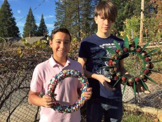 Sierra Academy of Expeditionary Learning students Aiden Keller, left, and Sebastian Merrick show off some of the wreaths available for sale at SAEL's holiday fundraiser on Dec. 3.