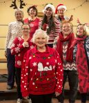 """Above, Grass Valley and Nevada City residents Patti McClure, Bev Miller, Val Fritzsche, Kathy Triolo, Marge Biddle, Cindy Henry, Bonnie Steward and Barbara Terhorst are just a few of the women from Sierra Gold Chorus preparing for an afternoon performance of  """"Christmas Carols and Cooking Chaos,"""" in  Auburn on Dec. 10."""