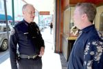 Grass Valley Police Chief John Foster talks to local business owner James Arbaugh of Stucki Jewelers in downtown Grass Valley.