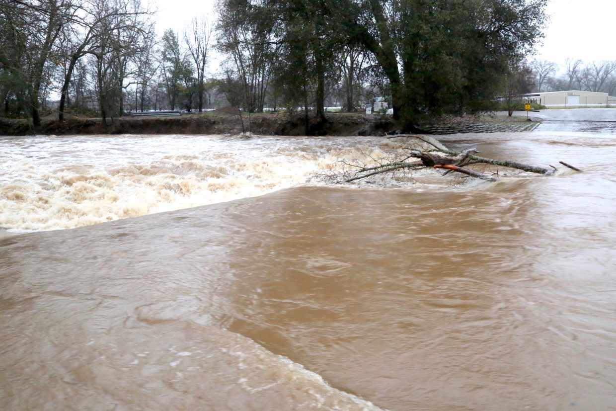 Squirrel Creek in Penn Valley gushes with water Saturday morning.