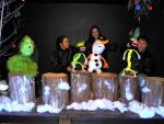 """From left, Michelle McVicker (the Grinch), Mary Parker (Candy), Marissa McVicker (Olaf/Frosty) and Matthew Parker (Cane) rehearse for this holiday's season's black light puppet production of """"Frosty."""""""