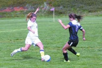 Nevada Union's Eva Caisse kicks the ball during a game against Woodcreek Wednesday afternoon.