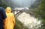 A big rain storm hit Northern California and Western Nevada County Sunday. People flock to the Old Highway 49 bridge Sunday afternoon watching the rushing water in the South Fork Yuba River.