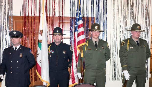 The Honor Guard of Nevada County Consolidated Fire, Grass Valley Police, and Nevada Country Sheriff offices presented the colors at the 18th Annual Red Light Ball.