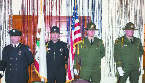 Photo by John Hart the 18th Annual Red Light Ball, presented by the Nevada County Law Enforcement and Fire Protection council, Saturday evening, Alta Sierra Country Club. The Honor Guard of Nevada County Consolidated Fire, Grass Valley Police, and Nevada Country Shereff presented the colors.