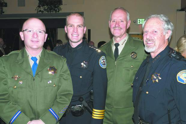 Photo by John Hart the 18th Annual Red Light Ball, presented by the Nevada County Law Enforcement and Fire Protection council, Saturday evening, Alta Sierra Country Club. The four local law enforcement chief's in Western Nevada County who attended the event, left to right are: California Highway Patrol Area Commander George Steffenson, Grass Valley Police Chief Alex Gammelgard, Nevada County Sheriff Keith Royal, and Nevada City Tim Foley.
