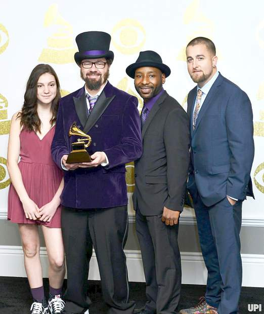 """From left, Saki Sullivan, Cactus Skidoo, J. Kendall and Spends Quality pose after Secret Agent 23 Skidoo won the Grammy for """"Best Children's Album"""" for 2016's """"Infinity Plus One."""""""