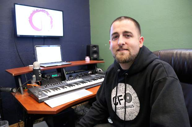 """Music producer Spends Quality works the controls in his studio Cedarsong Sound, where much of the Grammy Award-winning album """"Infinity Plus One"""" was created."""
