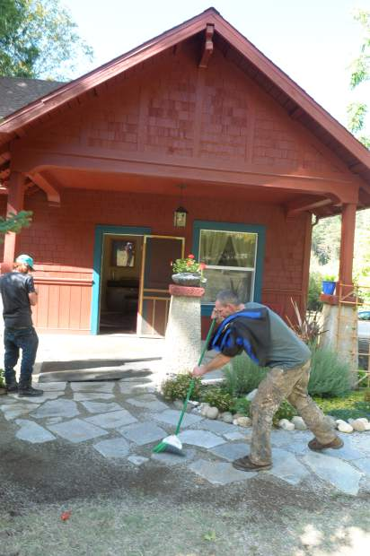 Homeless volunteers take care of chores around Nevada City's Streicher House Tuesday October 18.