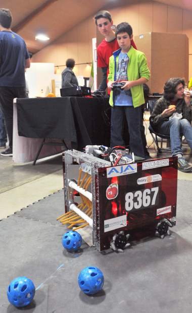 Nevada Union High School's Ryan Brott (left) assists Mt. St. Mary's Nikolas Palacio, who is really in to robotics, with a robot designed to pick up wiffle balls, and shoot them into a target. The robot was the Go ACME Robotic's entry into the FIRST international organization's regional competition.
