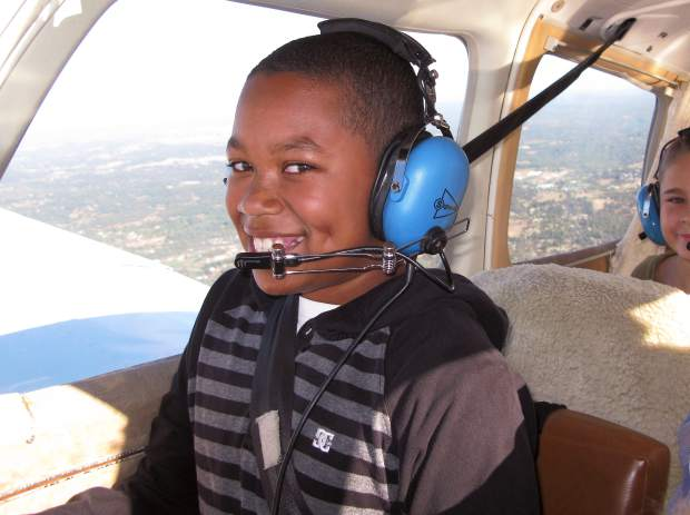 Bill Sommers, who has flown taken more than 1,400 youth on Young Eagles flights, makes sure each one gets a photo like this sent to them after the flight. Here, Asaiah Lewis takes the controls during her flight.