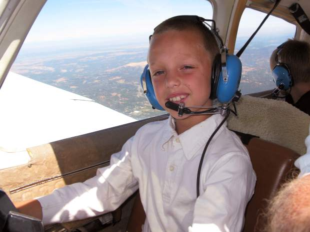 Skylar Miller takes the controls during his Young Eagles flight with Grass Valley pilot Bill Sommers.