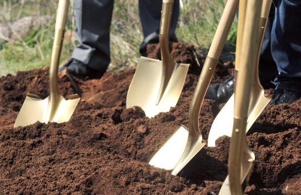 A set of golden shovels used typically for ground breaking ceremonies, sit poised to turn over the first shovelfulls of dirt during Thursday's ceremony.