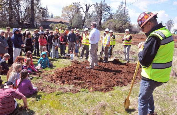 Eric Byous, United States Environmental Protection Agency's Brownsfields Manager for region nine (center) explains what was necessary to clean up the property to allow Yuba River Charter School to break ground on their new site along Rough and Ready Highway in Grass Valley.
